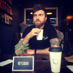 "Drew drinking coffee in Louisville at ""Please & Thank You""."